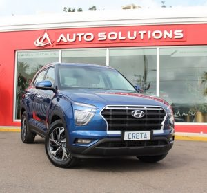 Hyundai Creta 2021, front view, blue color, outside of Auto Solutions showroom