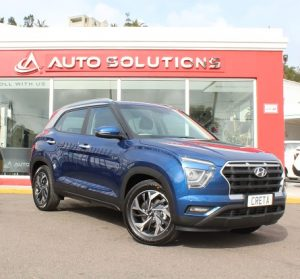 Hyundai Creta 2021, front right side view, blue color, outside of Auto Solutions showroom