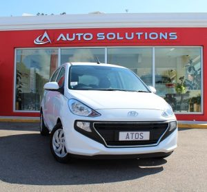 HYUNDAI ATOS front view, white color, in front of Auto Solutions Showroom