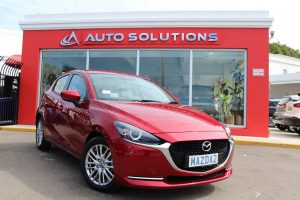 Mazda 2 soul crystal red, outside of Auto Solutions
